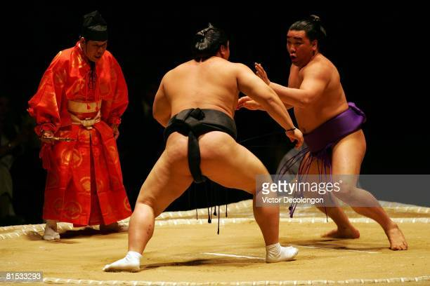 Ama right looks to defend himself against Hakuho in the fourth round during the 2008 Grand Sumo Tournament at the Los Angeles Memorial Sports Arena...