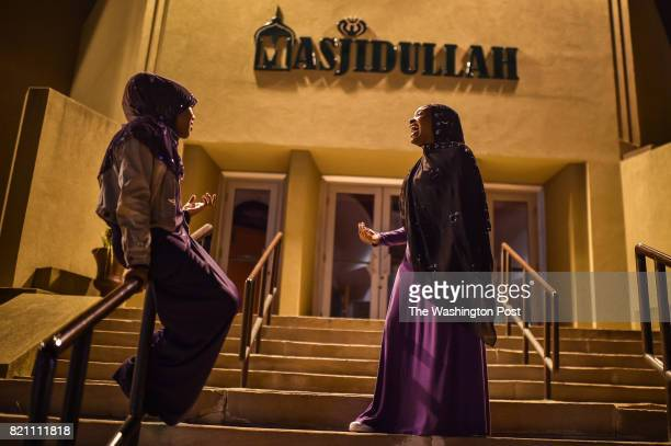Amaarah Abdrrahman of Philadelphia PA speaks with her friend Alnisa Elshalom of Philadelphia PA outside of Masjidullah after Iftar dinner during...