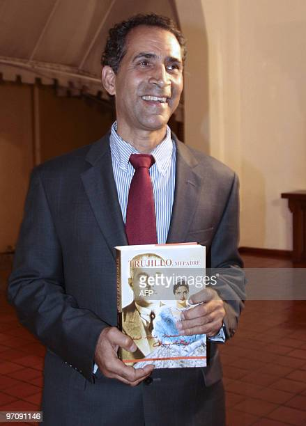Amable Trujillo great nephew of late Dominican Republic dictator Rafael Trujillo shows a book written by Angelita Trujillo daughter of the dictator...
