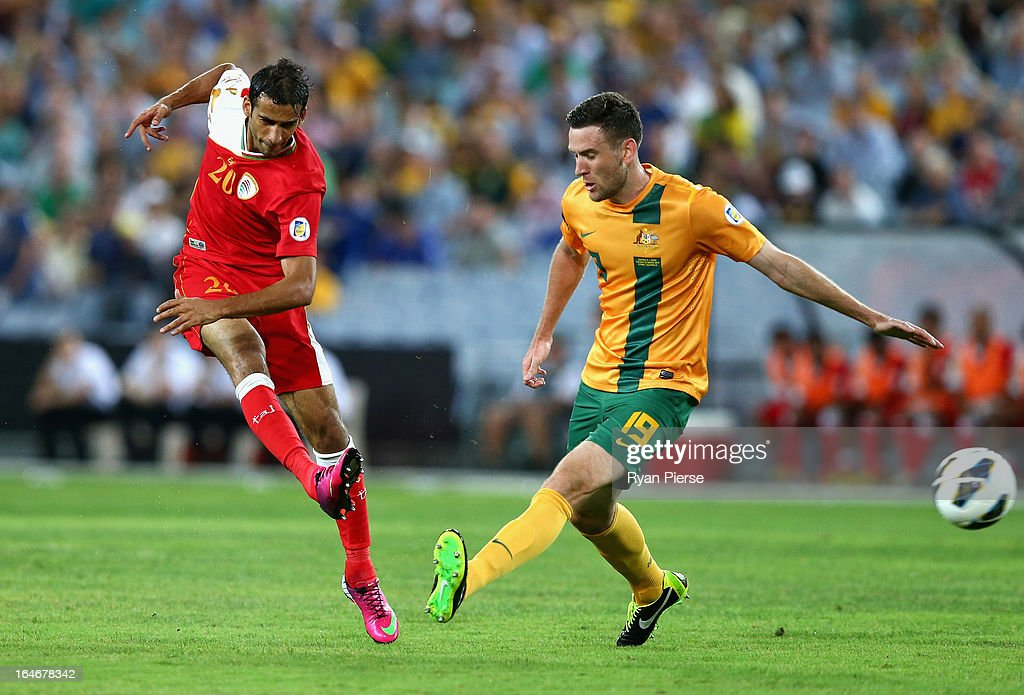 Amad Al Hosni of Oman shoots past Robbie Cornthwaite of the Socceroos during the FIFA 2014 World Cup Qualifier match between the Australian Socceroos and Oman at ANZ Stadium on March 26, 2013 in Sydney, Australia.