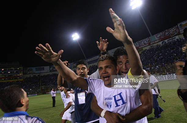 Amado Guevara and Carlos Costly of Honduras celebrate victory over El Salvador during their match as part of the 2010 FIFA World Cup Qualifier at...