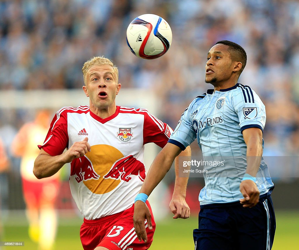 Amadou Dia of Sporting KC battles Mike Grella of the New York Red Bulls for a head ball during the game at Sporting Park on March 8 2015 in Kansas...