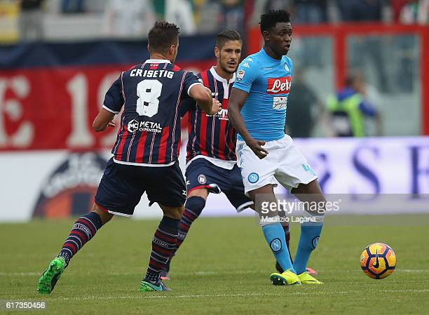 Amadou Diawara of Crotone competes for the ball with Lorenzo Crisetig of Napoli during the Serie A match between FC Crotone and SSC Napoli at Stadio...