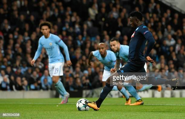 Amadou Diawara of SSC Napoli scores his sides first goal from the penalty spot during the UEFA Champions League group F match between Manchester City...