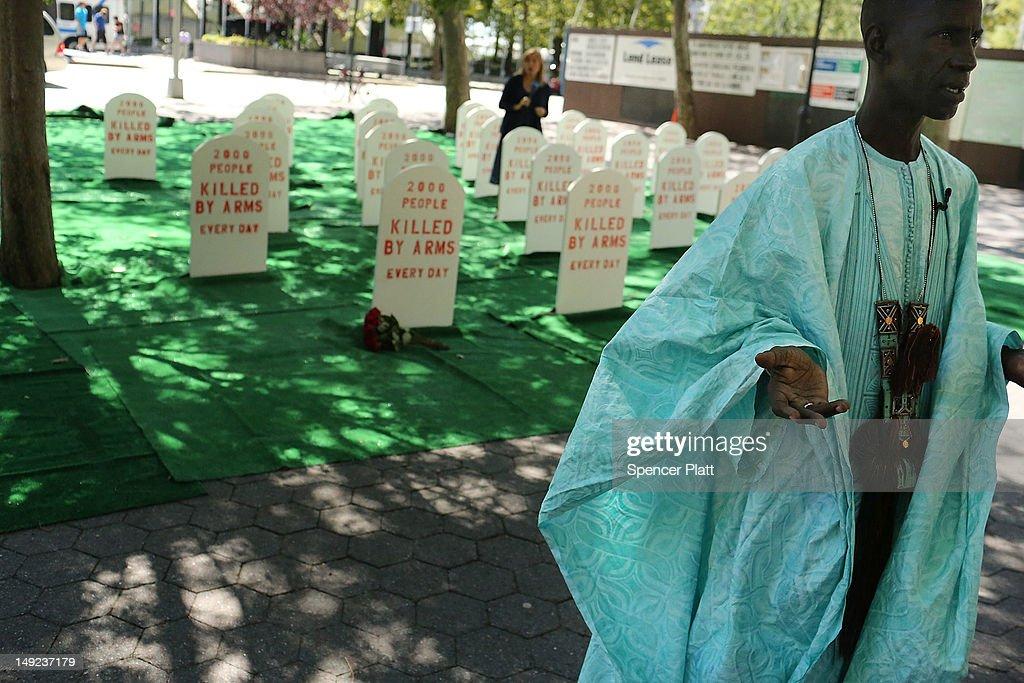 Amadou Maiga from Mali , who has lost friends in conflict, speaks in front of a mock graveyard across from the United Nations (UN) which represents those killed by arms everyday around the world on July 25, 2012 in New York City. The group Control Arms set up the campaign to help draw attention to the issues of deaths by guns and other armaments while negotiations continue at the UN for a new Arms Trade Treaty.