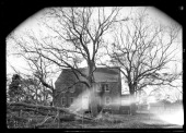 unidentified woodshake house viewed through bare trees New York New York late 19th or early 20th century