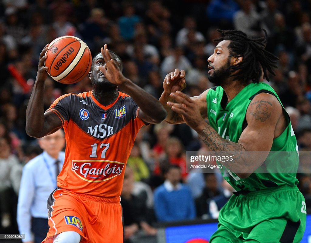 Amagou of Le Mans (L) vies with Watkins of ASVEL (R) during the Basketball men's National Cup Final match between ASVEL and Le Mans at Hotel Accor Arena Bercy on May 1, 2016 in Paris, France.