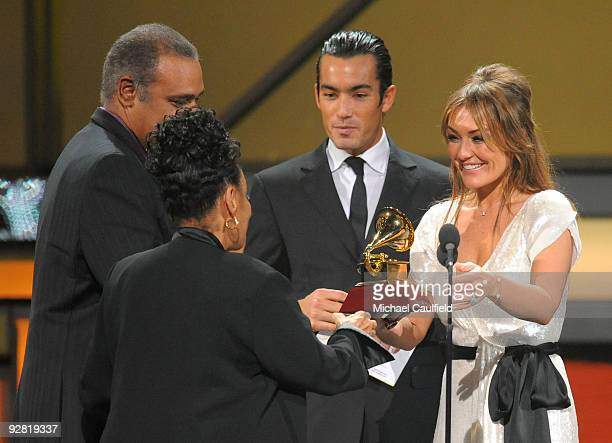 Amaia Montero and Aaron Diaz present an award to Omara Portuondo onstage at the 10th Annual Latin GRAMMY Awards held at the Mandalay Bay Events...