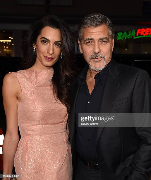 Amal Alamuddin and actor George Clooney attend the premiere of Warner Bros Pictures' 'Our Brand Is Crisis' at TCL Chinese Theatre on October 26 2015...