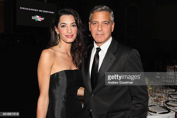 Amal Alamuddin and George Clooney attend the Celebrity Fight Night In Italy Benefitting The Andrea Bocelli Foundation and The Muhammad Ali Parkinson...
