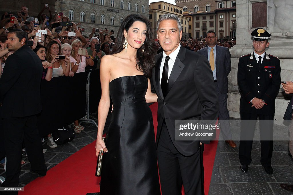 <a gi-track='captionPersonalityLinkClicked' href=/galleries/search?phrase=Amal+Alamuddin&family=editorial&specificpeople=12534567 ng-click='$event.stopPropagation()'>Amal Alamuddin</a> and <a gi-track='captionPersonalityLinkClicked' href=/galleries/search?phrase=George+Clooney&family=editorial&specificpeople=202529 ng-click='$event.stopPropagation()'>George Clooney</a> attend the Celebrity Fight Night In Italy Benefitting The Andrea Bocelli Foundation and The Muhammad Ali Parkinson Center Gala on September 7, 2014 in Florence, Italy.