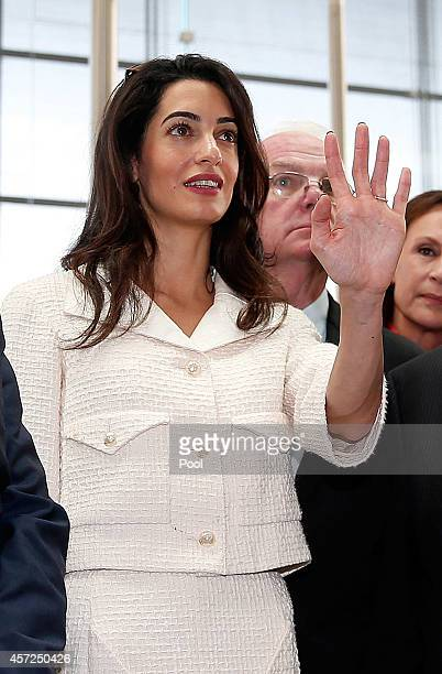 Amal Alamuddin Clooney gestures during a visit at the Parthenon hall inside the museum in Athens on October 15 2014 in Athens Greece Human rights...