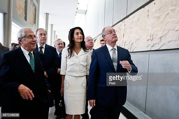 Amal Alamuddin Clooney is guided by minister of Culture and Sports Konstantinos Tasoulas and president of the Acropolis museum Dimitris Pantermalis...