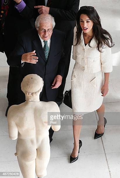 Amal Alamuddin Clooney is guided by the president of the Acropolis museum Dimitris Pantermalis during a visit at the museum on October 15 2014 in...