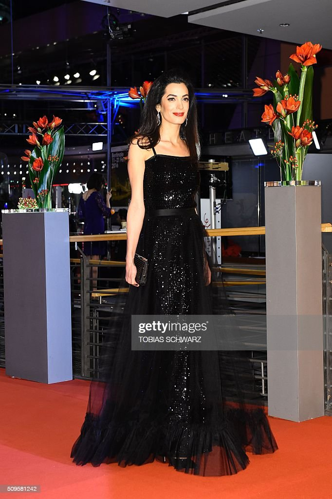 Amal Alamuddin Clooney poses for photographers as she arrives for the film 'Hail, Caesar!' screening as opening film of the 66th Berlinale Film Festival in Berlin on February 11, 2016. / AFP / TOBIAS SCHWARZ