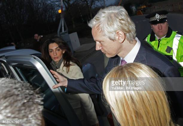 Amal Alamuddin leaving in a taxi with WikiLeaks founder Julian Assange who is facing extradition to Sweden where he is under investigation for...