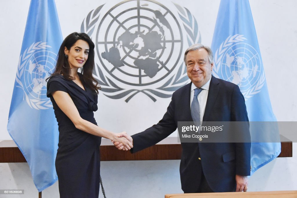 Amal Clooney (L) and 9th Secretary-General of the United Nations António Guterres shake hands at United Nations Headquarters on March 10, 2017 in New York City.
