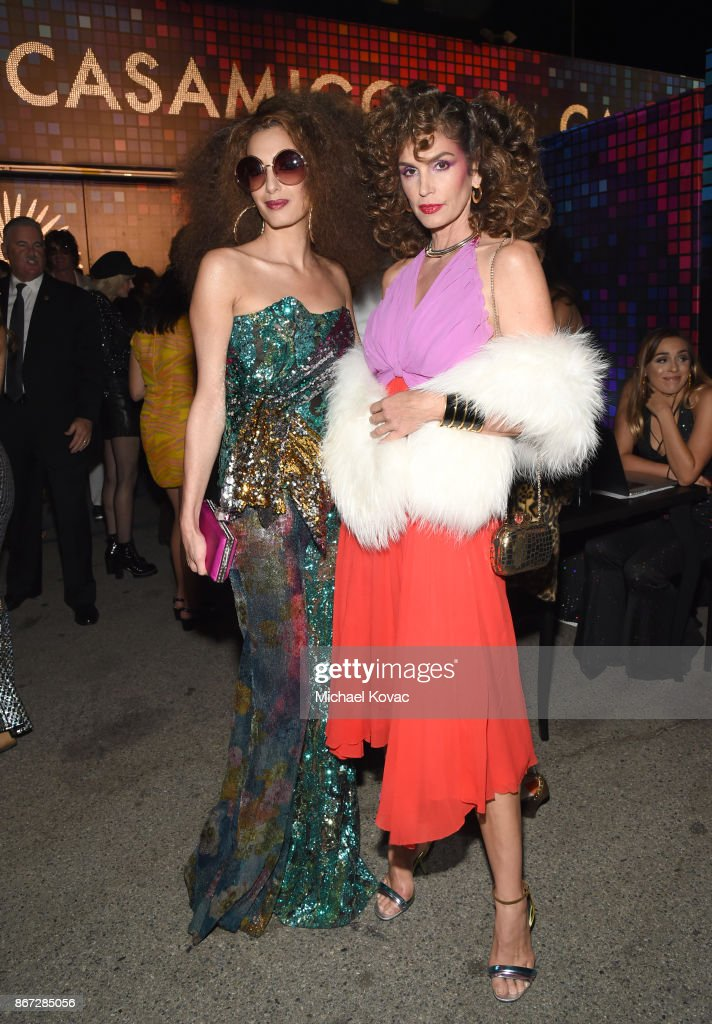 Amal Clooney (L) and Cindy Crawford attend Casamigos Halloween Party on October 27, 2017 in Los Angeles, California.