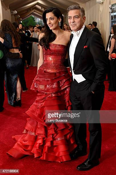 Amal Clooney and George Clooney attend the 'China Through The Looking Glass' Costume Institute Benefit Gala at the Metropolitan Museum of Art on May...