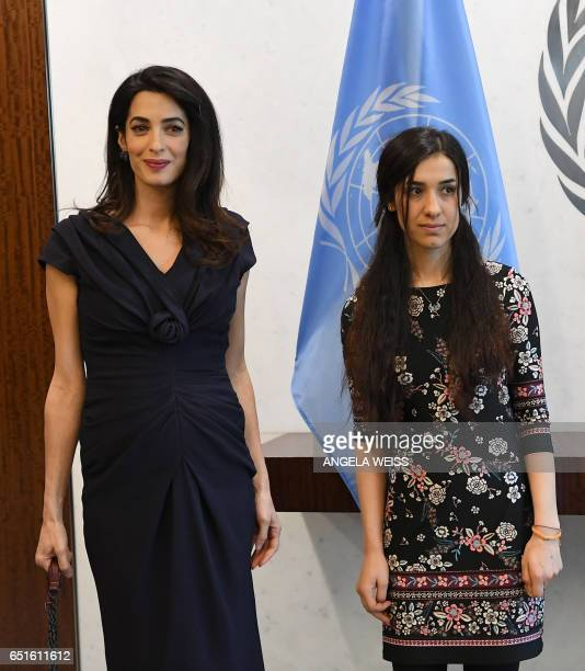 Amal Clooney and Nadia Murad meet with SecretaryGeneral of The United Nations Antonio Guterres at the UN Headquarters on March 10 2017 in New York...