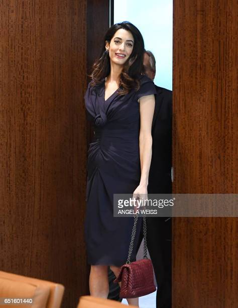 Amal Clooney arrives with SecretaryGeneral of The United Nations Antonio Guterres at the UN Headquarters on March 10 2017 in New York / AFP PHOTO /...