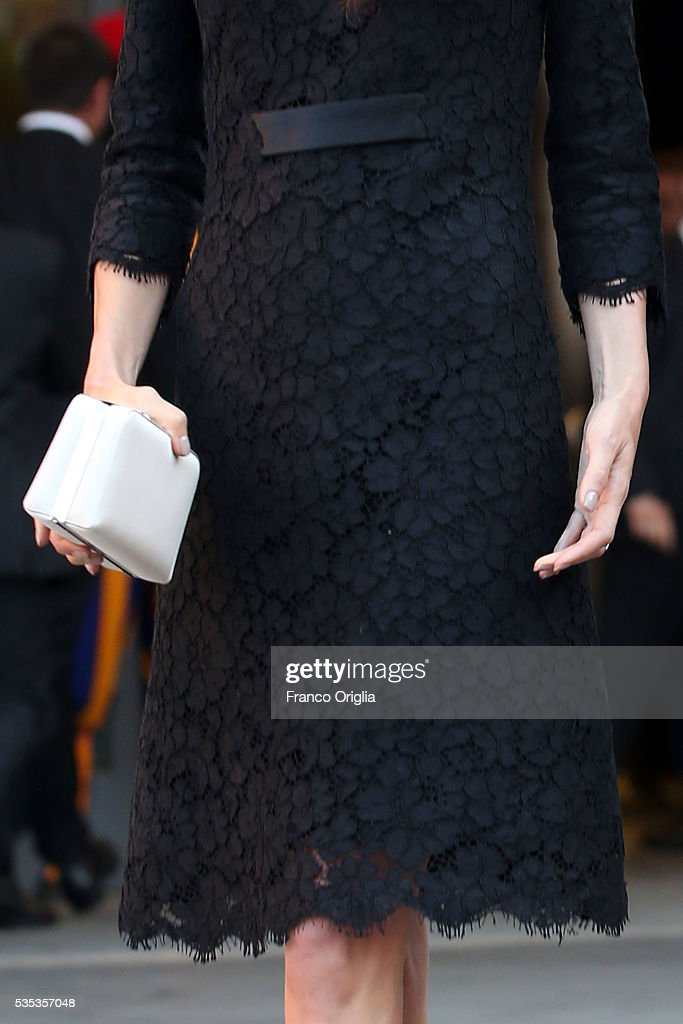 Amal Clooney (bag and dress detail) leaves at the end of 'Un Muro o Un Ponte' Seminary held by Pope Francis at the Paul VI Hall on May 29, 2016 in Vatican City, Vatican.