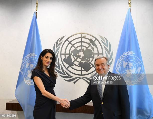 Amal Clooney meets with SecretaryGeneral of the United Nations Antonio Guterres at the UN Headquarters on March 10 2017 in New York / AFP PHOTO /...