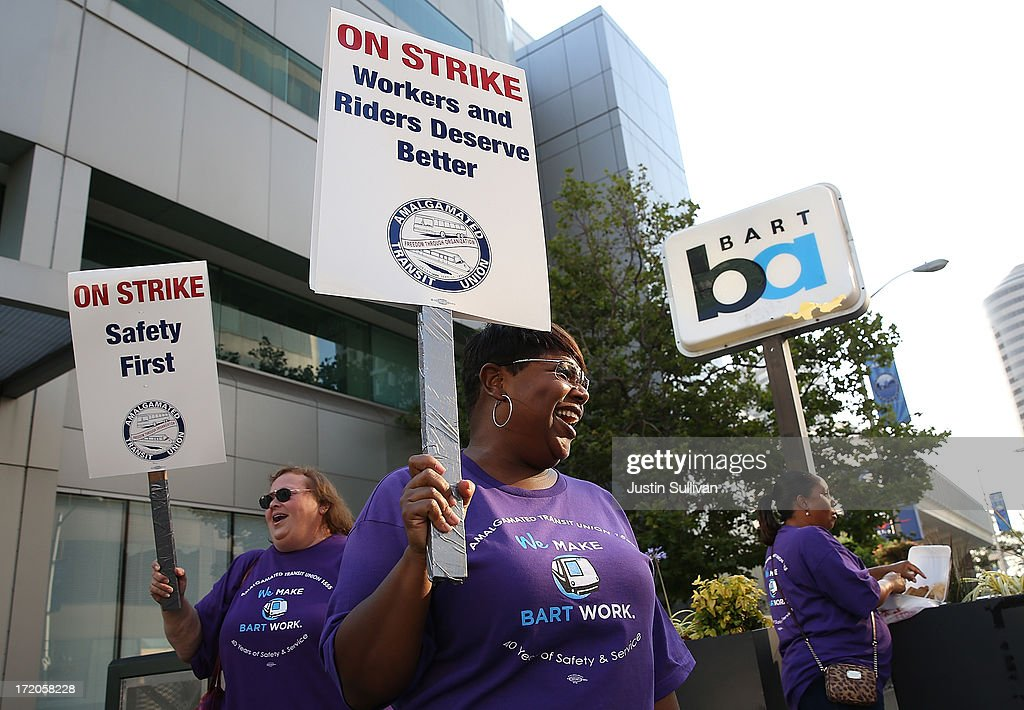 Amalgamated Transit Union workers hold signs as they strike outside of a Bay Area Rapid Transit (BART) station on July 1, 2013 in Oakland, California. Hundreds of thousands of San Francisco Bay Area commuters are scrambling to find ways to work after the Bay Area Rapid Transit (BART) workers from the Amalgamated Transit Union Local 1555 went on strike at midnight after contract negotiations with management fell apart on Sunday. Train operators, mechanics, station agents and maintenance workers are seeking a five percent wage increase and are fighting management who want to have workers to begin contributing to their pensions, pay more for health insurance and reduce overtime expenses.