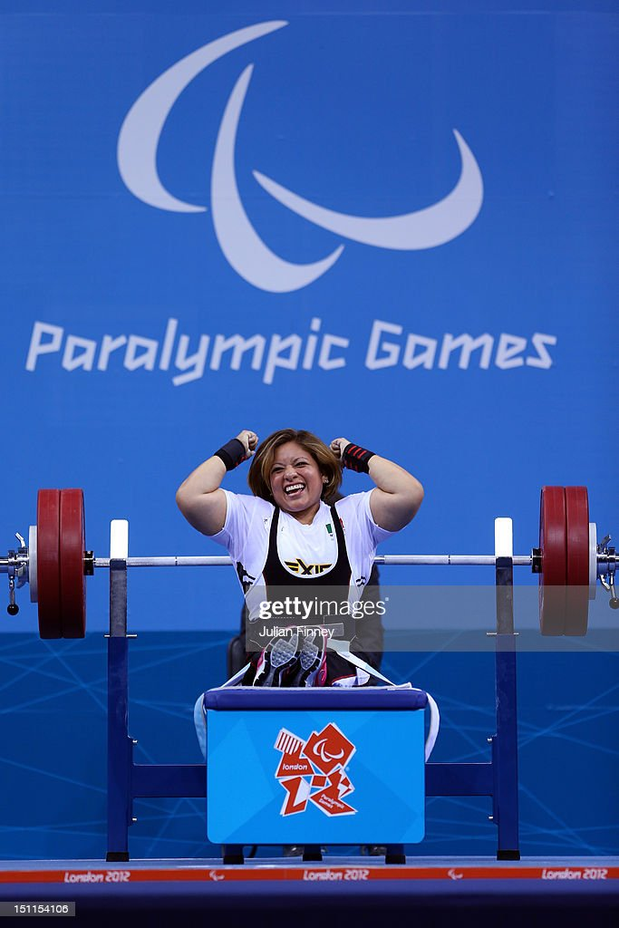 Amalia Perez of Mexico celebrates winning gold in the Women's 60kg Powerlifting on day 4 of the London 2012 Paralympic Games at ExCel on September 2...