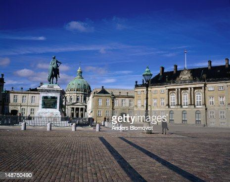 Amalienborg Palace residence of Queen Margrethe II, the dome of Marble church and the statue of King Frederik V at Frederiksstaden.