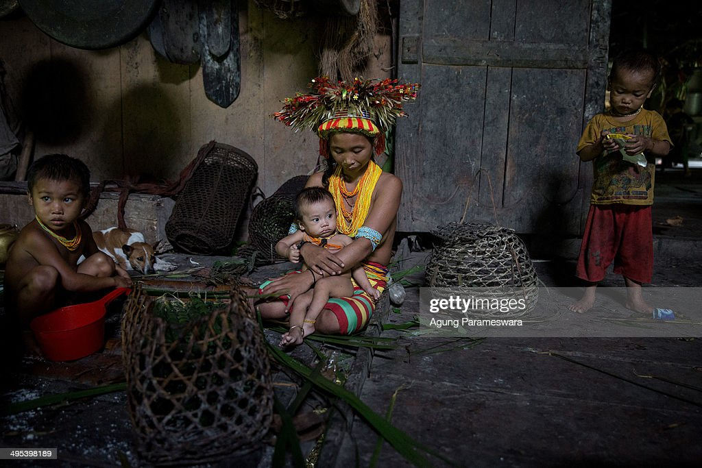Aman Gotdai's wife Bai Gotdai holds her son during Inauguration Ritual for Aman Gotdai as a New Sikerei on May 26 2014 in Butui Village Siberut...