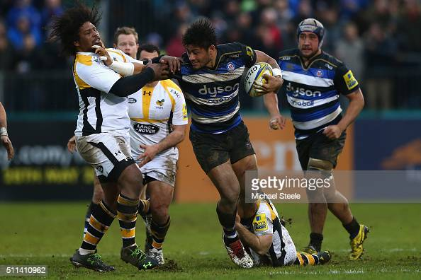 Amanaki Mafi of Bath holds off the challenge from Ashley Johnson of Wasps during the Aviva Premiership match between Bath and Wasps at the Recreation...