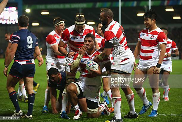 Amanaki Mafi of Japan celebrates scoring their third try during the 2015 Rugby World Cup Pool B match between USA and Japan at Kingsholm Stadium on...