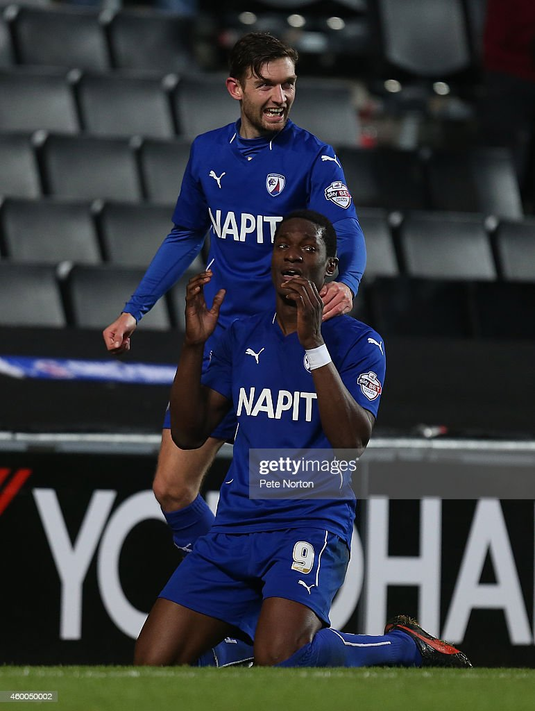 Amand Gnanduillet (kneeling) of Chesterfield celebrates with team mate Jay O'Shea after scoring his sides goal during the FA Cup Second Round match between MK Dons and Chesterfield at Stadium mk on December 6, 2014 in Milton Keynes, England.