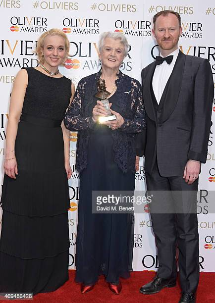 Amanda Abbington Dame Angela Lansbury winner of the Best Actress in a Supporting Role for 'Blithe Spirit' and Mark Gatiss pose in the winners room at...