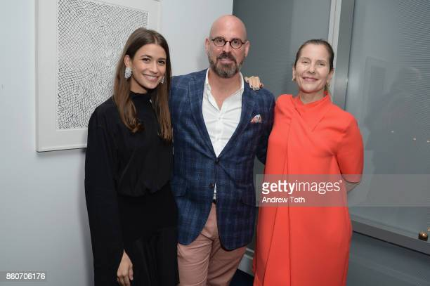 Amanda Alagem Andres Sosa and Paola Antonelli attend as Harper's BAZAAR and THE OUTNETCOM Celebrate the opening of MoMA's Fashion Exhibit 'Is Fashion...