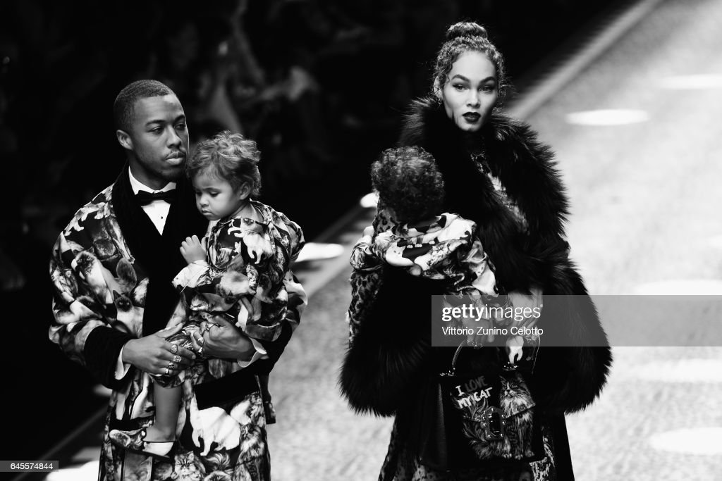Amanda and Jason Harvey with their children Noah and Rose walk the runway at the Dolce & Gabbana show during Milan Fashion Week Fall/Winter 2017/18 on February 26, 2017 in Milan, Italy.