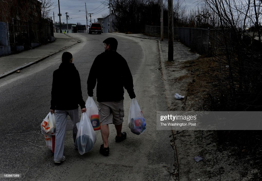 Amanda Aubin and Cody Allison carry $70.00 worth of groceries to their apartment about one-half mile away. They had money left over on their food stamp card but this amount of food was all that they could carry on foot. Some of the items purchased were for their 4 year-old daughter who was having a birthday party the next day. Many families and individuals in Woonsocket, Rhode Island are needy and take part in the SNAP (food stamps) program. Photo by Michael S. Williamson/The Washington Post via Getty Images