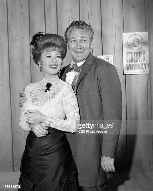 Amanda Blake as Kitty Russell and Forrest Tucker as Brad McClain on the GUNSMOKE episode 'Double Entry' Image dated October 27 1964