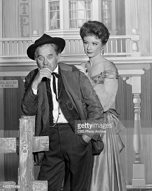 Amanda Blake as Kitty Russell and Milburn Stone as Doc Adams and in GUNSMOKE Image dated May 27 1960