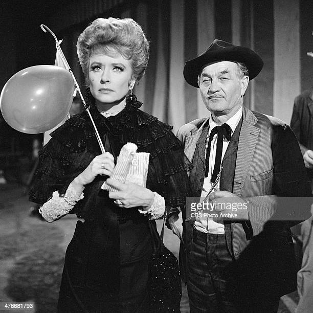 Amanda Blake as Kitty Russell and Milburn Stone as Doc Adams in the GUNSMOKE episode 'Circus Trick' Image dated June 8 1964