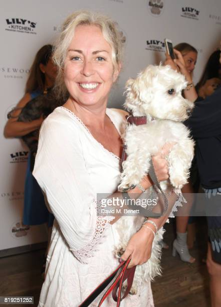 Amanda Bretherton and Alfie fashion dog attend the launch of Rosewood's Canine Luxury Experience hosted by Rosewood London and Barbour at Rosewood...