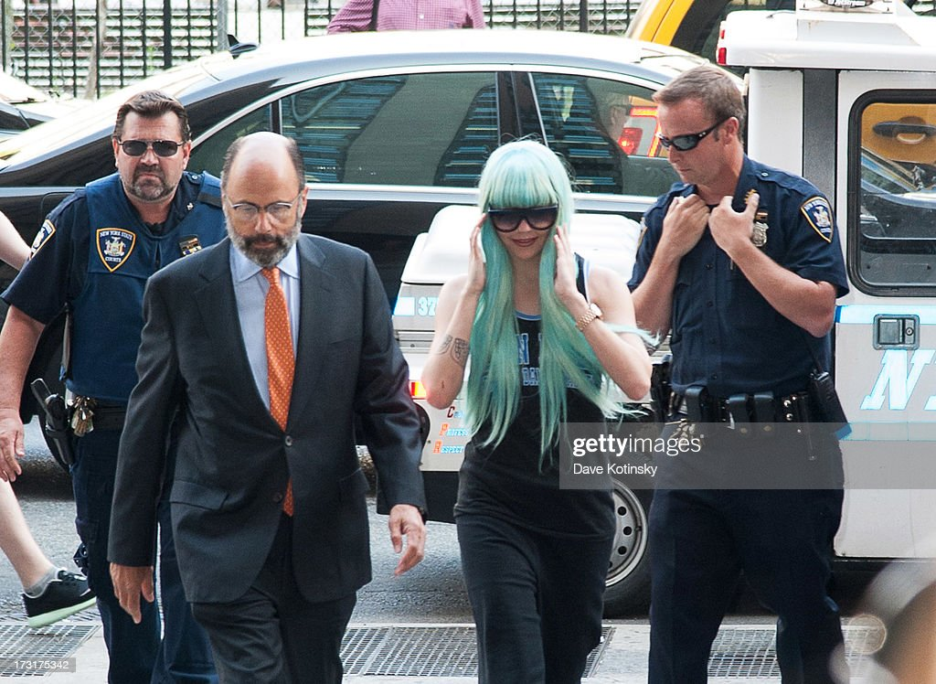 Amanda Bynes arrives for an appearance at Manhattan Criminal Court on July 9, 2013 in New York City. Bynes is facing charges of reckless endangerment, tampering with evidence and criminal possession of marijuana in relation to her arrest on May 23, 2013.
