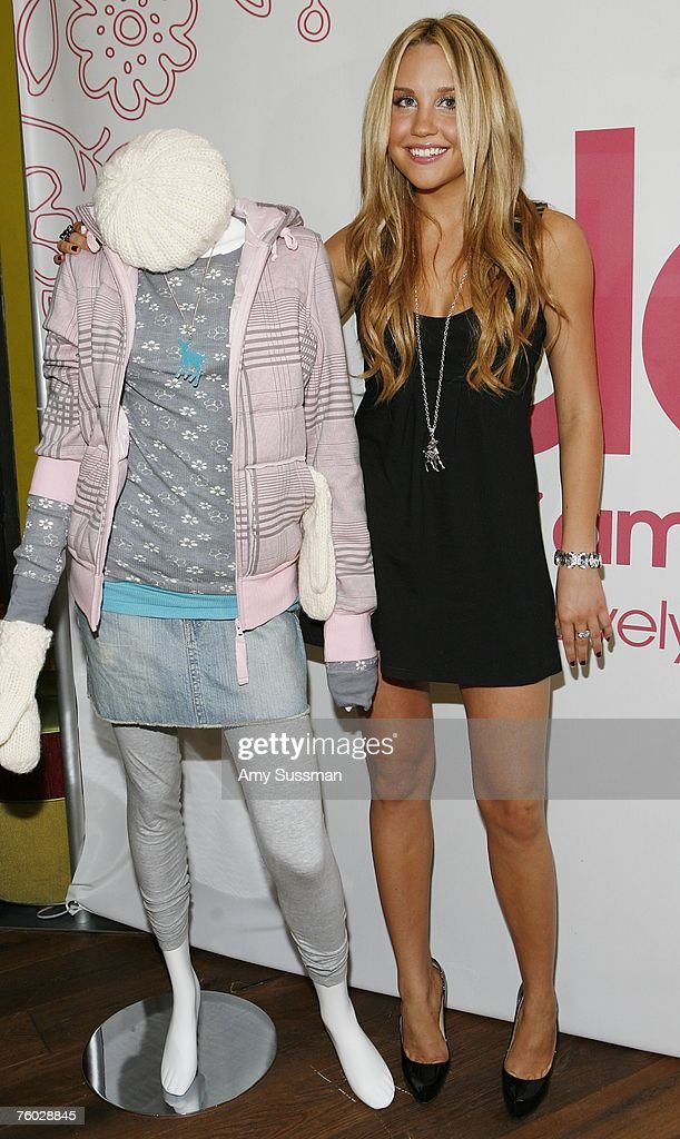 <a gi-track='captionPersonalityLinkClicked' href=/galleries/search?phrase=Amanda+Bynes&family=editorial&specificpeople=201660 ng-click='$event.stopPropagation()'>Amanda Bynes</a> poses at the launch party of her new clothing line ''DEAR'' at Sushi Samba on August 8, 2007 in New York City.