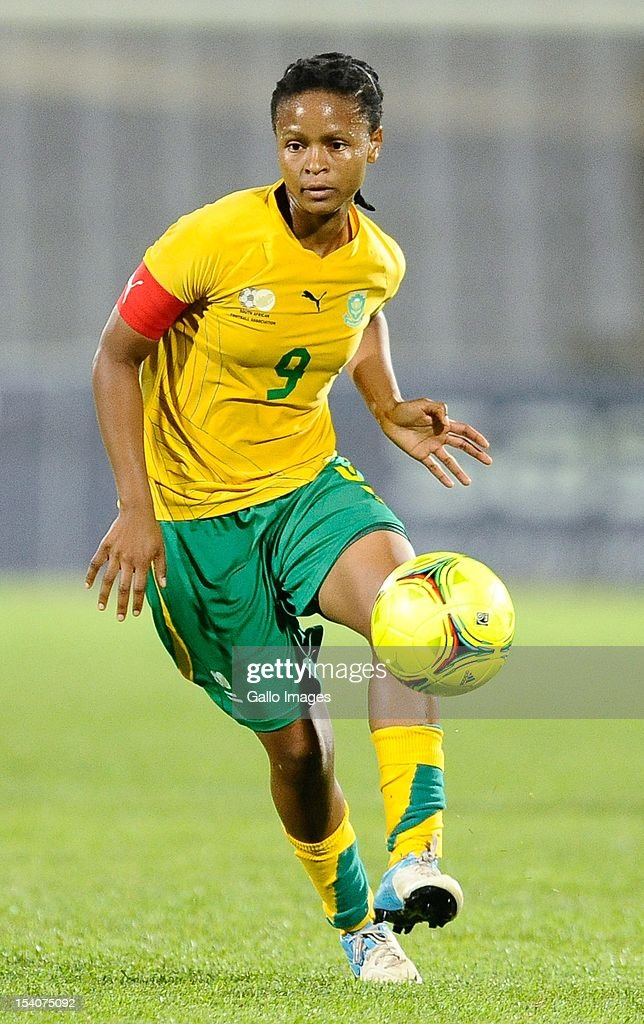 Amanda Dlamini passes the ball during the Womens International Friendly match between South Africa and Zimbabwe from Volkswagen Dobsonville Stadium on October 13, 2012 in Dobsonville, South Africa.