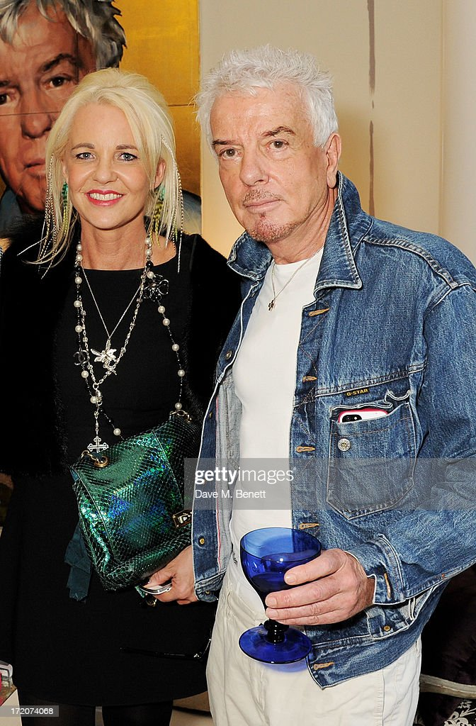 <a gi-track='captionPersonalityLinkClicked' href=/galleries/search?phrase=Amanda+Eliasch&family=editorial&specificpeople=795582 ng-click='$event.stopPropagation()'>Amanda Eliasch</a> (L) and Nicky Haslam attend the launch of Nicky Haslam's new album 'Midnight Matinee' on July 1, 2013 in London, England.