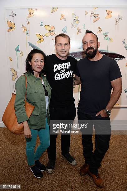 Amanda Fairey artist Shepard Fairey and photographer Michael Muller attend the Opening Reception for Michael Muller's book 'Shark' hosted by TASCHEN...