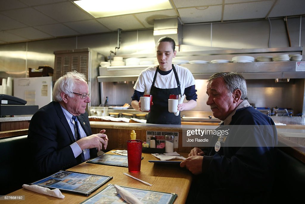 Amanda Hale serves coffee to Democratic presidential candidate <a gi-track='captionPersonalityLinkClicked' href=/galleries/search?phrase=Bernie+Sanders&family=editorial&specificpeople=2908340 ng-click='$event.stopPropagation()'>Bernie Sanders</a> (D-VT) and United Steelworkers President, Local 1999, Chuck Jones, as they have breakfast at Peppy Grill on May 3, 2016 in Indianapolis, Indiana. Indiana voters went to the polls today as they decide who to cast their ballot for during the states primary election.