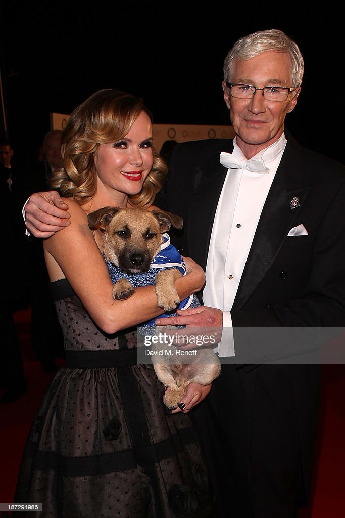 Amanda Holden and Paul O'Grady attend the annual Collars and Coats gala ball in aid of Battersea Dogs & Cats home at Battersea Evolution on November 7, 2013 in London, England.
