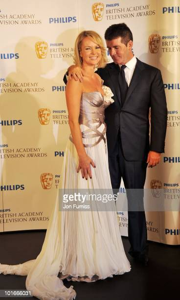 Amanda Holden and Simon Cowell pose in the press room at the Philips British Academy Television Awards at London Palladium on June 6 2010 in London...